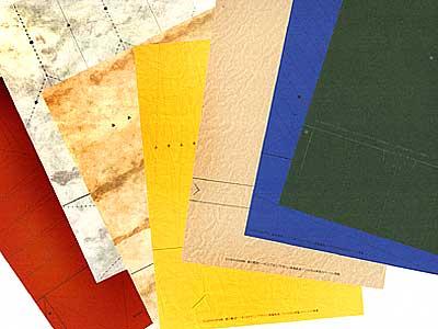鹿島建設社内報の連載「紙の彫刻」の型紙を何枚も並べる